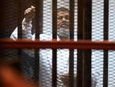 مرسي ودفاعه يطالبان بمحاكمة السيسي ومنصور