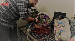 الطباعة المائية.. مشروع أبدعه شاب غزي في طريق بحثه عن فرصة عمل