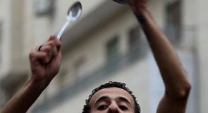 """بالصور.. مسيرة """"أوركسترا الأمعاء الخاوية"""" في رام الله"""