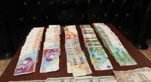 القبض على المتهمين بسرقة 100 ألف دولار من مصرف غريز  برفح