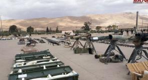 فيديو| مسلحو القلمون الشرقي يسلمون الجيش السوري ترسانة ضخمة من الأسلحة