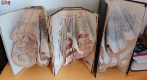 """""""حميد"""" يعيد الحياة للكتب القديمة باحترافه فن الأوريغامي"""