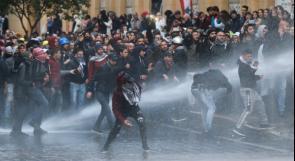 متظاهرون يحتشدون حول البرلمان اللبناني وصدامات مع الشرطة