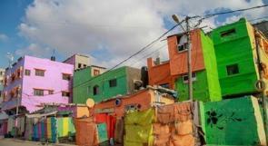 """خاص لـ""""وطن"""": بالفيديو.. """"غزة أحلى"""".. مبادرة لتزيين جدران منازل مخيم الشاطئ"""