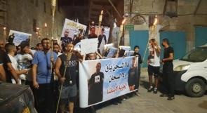 مسيرة مشاعل في عكا دعما لمعتقلي الهبة الشعبية