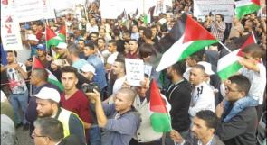 الآلاف في الخليل ونابلس يطالبون بتجميد الضمان