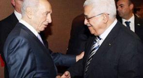 بيريز: اجتمعت مع عباس سراً بمعرفة نتانياهو