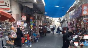 """على بعد أيام من العيد .. الـ """"جيوب"""" خاوية وأسواق غزة """"نائمة"""""""