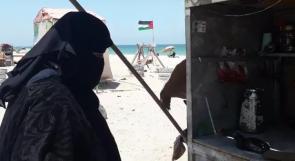 تبيع القهوة على شاطئ غزة لتطعم أطفالها.. أبو لبدة تناشد عبر وطن لمساعدتها