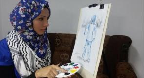 """خاص لـ """"وطن"""": بالفيديو.. رفح: تسنيم.. تستخدم بصمتها وغطاء القلم أدوات للرسم"""
