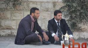 رغم البرد.. حملة دكتوراة يعتصمون مع عائلاتهم أمام مجلس الوزراء