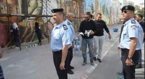 بالصور... الشرطة تشارك في طلاء 'أكبر جدارية في الوطن العربي'
