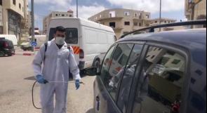 عائلة العويوي تبادر لتعقيم المركبات في مدينة الخليل للوقاية من فيروس كورونا