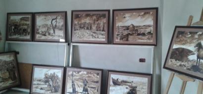 """خاص لـ""""وطن"""": بالفيديو.. بيت لحم: يزن يرسم تراث فلسطين القديم بالقهوة"""