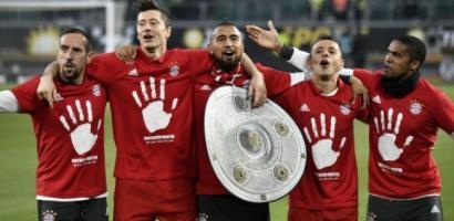 بايرن ميونيخ يتوج بلقب الدوري الألماني للمرة الخامسة على التوالي و27 في تاريخه