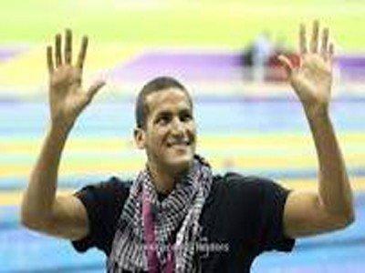 الملولي يهدي فوزه بـ 15 ذهبية الى فلسطين