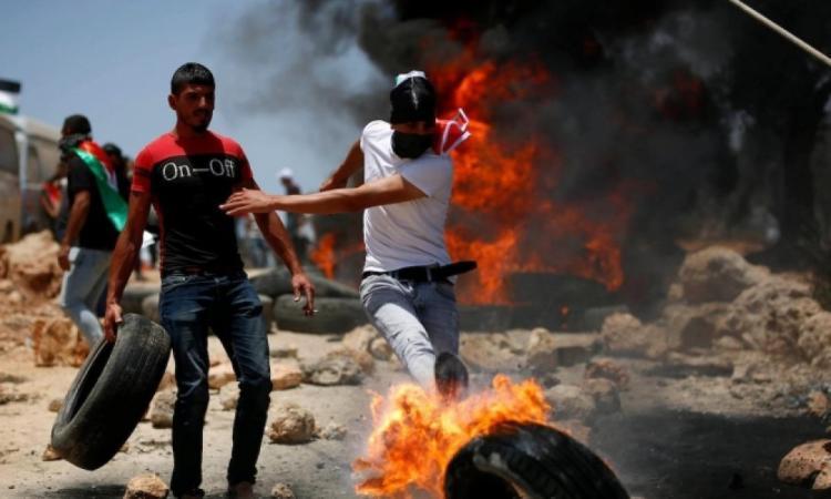 106 إصابة خلال المواجهات مع الاحتلال في بيتا عُقب استشهاد الشاب شادي سليم