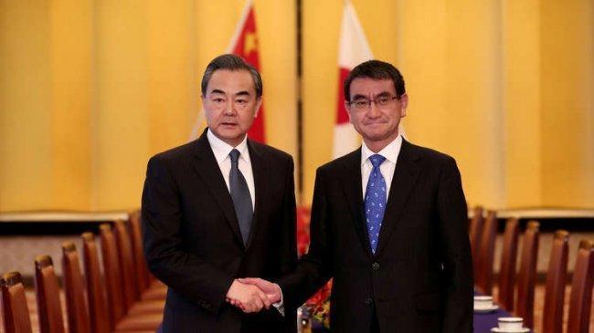 طوكيو وبكين تتفقان على أن الحرب التجارية ستضر بالاقتصاد العالمي